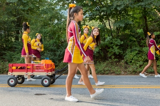 Cheerleaders for the Cherokee High School Braves walk in the 2016 Fall Fair Parade in Cherokee, North Carolina. October 4, 2016.