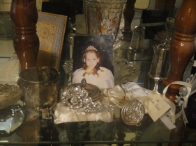 Inside the glass cabinet of antiques, mementos, and treasures